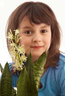 Smiling Girl With Blossom Flower Stock Photography