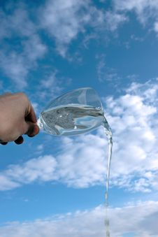 Glass Of Water Against A Cloudy Sky Stock Photos
