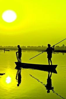 Silhouette: Fishermen On A Boat Stock Photography