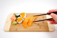 Trying To Pick Up Sushi With Chop Sticks Stock Images