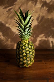 Pineapple On Wood Table Royalty Free Stock Images