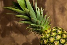 Pineapple On Wood Table Stock Photo