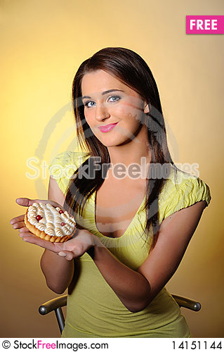 Free Young Beautiful Girl Eating Small Sweet Cake Stock Images - 14151144