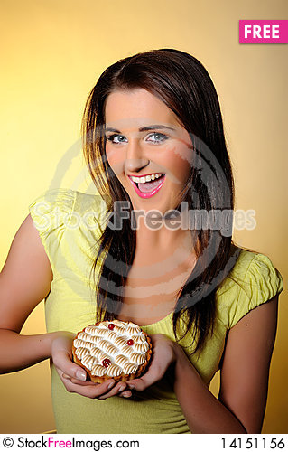 Free Young Beautiful Girl Eating Small Sweet Cake Royalty Free Stock Image - 14151156