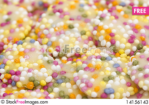Free White Chocolate Buttons With Sprinkles Stock Photos - 14156143