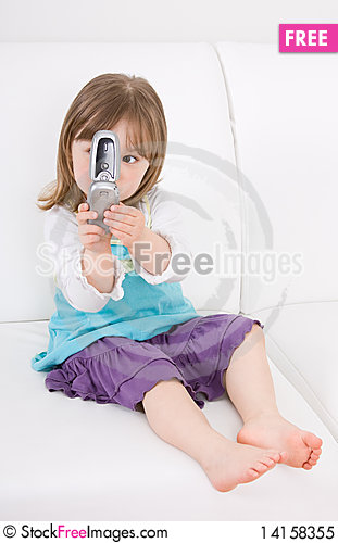 Free Little Girl With Mobile Phone Royalty Free Stock Photo - 14158355