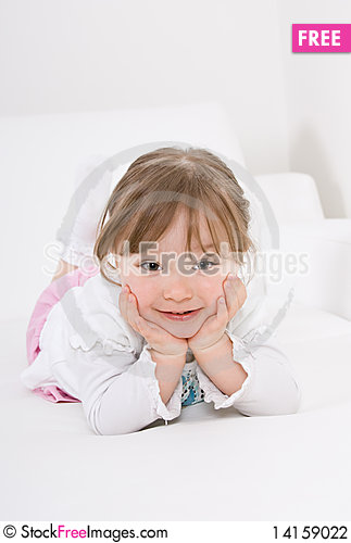 Free Little Girl On Sofa Stock Photography - 14159022