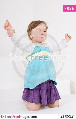 Free Little Girl On Sofa Stock Image - 14159041