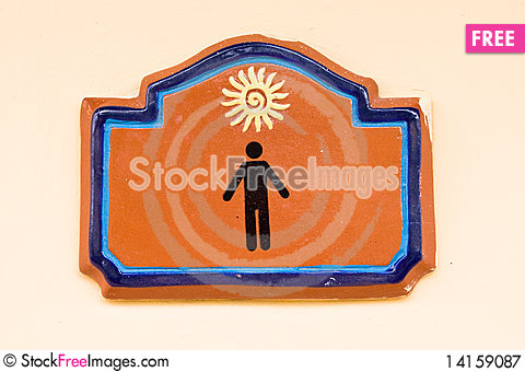 Free Brown Tablet On Men Enter Of Toilet Royalty Free Stock Photography - 14159087