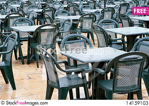 Free Many Green Plastic Chairs And Tables Stock Photos - 14159103