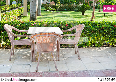 Free Brown Wooden Chairs An Tables On Patio Royalty Free Stock Images - 14159159