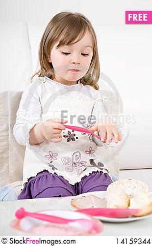 Free Little Girl Eating Stock Images - 14159344