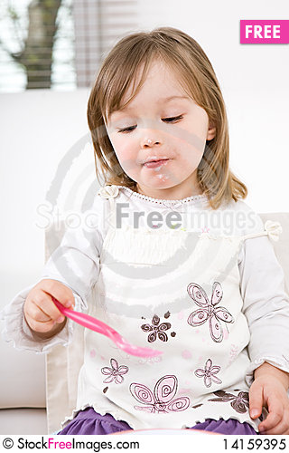 Free Little Girl Eating Royalty Free Stock Photo - 14159395