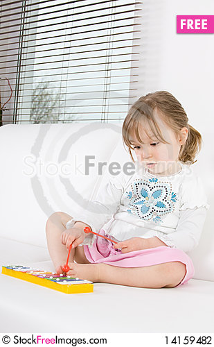 Free Little Girl With Instrument Stock Photography - 14159482