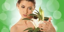 Free Portrait Of A Young Brunette Holding A Flower Royalty Free Stock Photography - 14150447