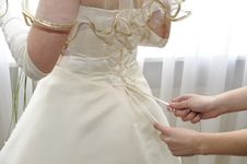 Free Female Hands Tightening A Corset To The Bride Stock Photo - 14150670