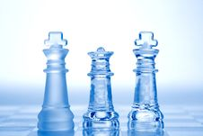 Glass Chess Pieces With Blue Light Royalty Free Stock Images
