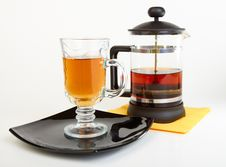 Сup Of Tea On Black Plate With Teapot Royalty Free Stock Photography