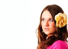 Girl With Flower In Hair Looking Right Royalty Free Stock Images