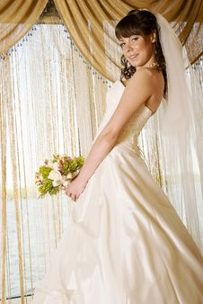 Bride In Front Of A Window Royalty Free Stock Images