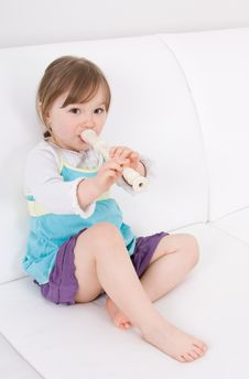 Little Girl With Instrument Stock Photo
