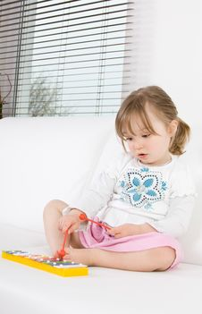 Little Girl With Instrument Stock Photography