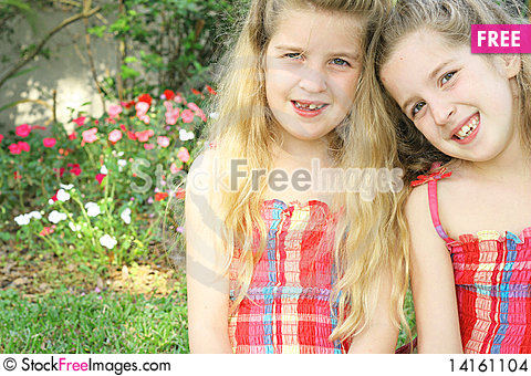 Free Identical Twin Sisters Together Stock Images - 14161104