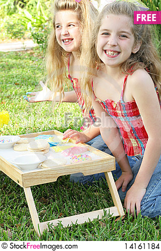 Free Happy Sisters Frosting Cookies Stock Images - 14161184