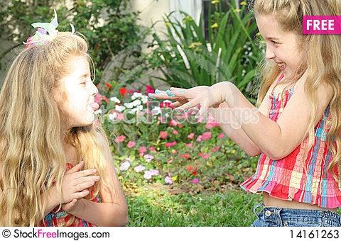 Free Teasing Sisters Stock Photos - 14161263