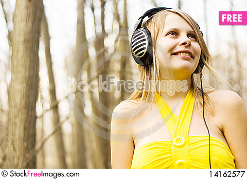 Free Girl Listening Music In Headphones. Spring Nature Royalty Free Stock Photography - 14162577