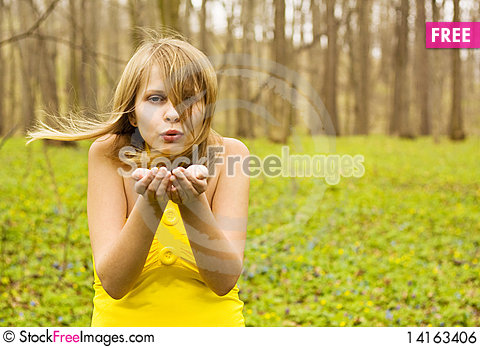 Free Attractive Woman Blowing Kiss In Spring Nature Royalty Free Stock Image - 14163406