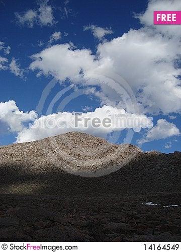 Free Boulder Pile Peeking Through Cloud Shadows Royalty Free Stock Images - 14164549
