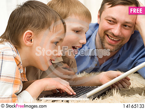 Free Two Brothers Playing On A Laptop Stock Photos - 14165133