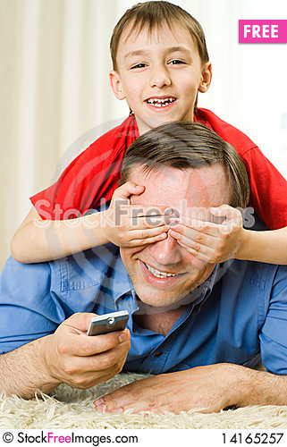 Free Son And Father Lying Royalty Free Stock Photography - 14165257