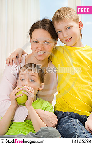 Free Mother Next To Her Two Children Stock Images - 14165324
