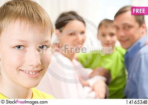 Free Boy Next To His Family Royalty Free Stock Photos - 14165348