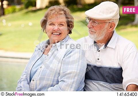 Free Happy Senior Couple In The Park Stock Photo - 14165400