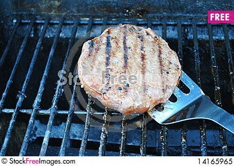 Free Flipping Hamburger On Grill Royalty Free Stock Photo - 14165965
