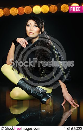 Free Sitting Brunette Asian Model Stock Photography - 14166022
