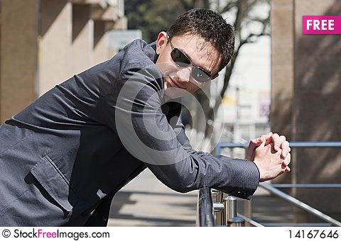 Free Young Adult Businessman Leans On Handrails Royalty Free Stock Image - 14167646