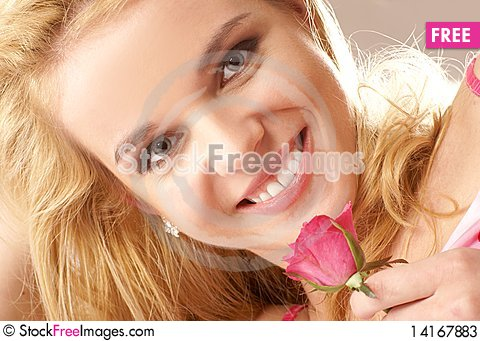 Free Portrait Of A Young Blond With A Flower Stock Photos - 14167883