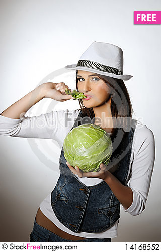 Free Young Pretty Woman With Green Cabbage Stock Photography - 14168552