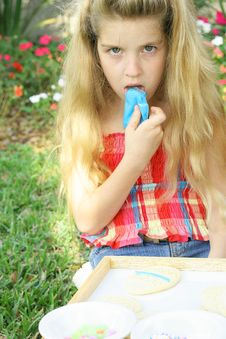 Child Licking Blue Frosting