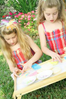 Little Girls Decorating Cookies Vertical Royalty Free Stock Photography