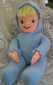 Crocheted Doll Wearing Blue Royalty Free Stock Images