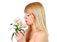 Free Portrait Of A Woman Holding Pink Flowers Royalty Free Stock Image - 14161846