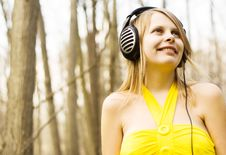 Girl Listening Music In Headphones. Spring Nature Royalty Free Stock Photography