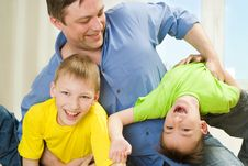 Brothers And Father Playing Royalty Free Stock Images