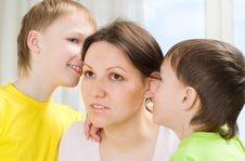 Mother Next To Children Stock Image