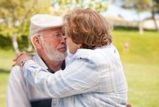 Happy Senior Couple In The Park Stock Photo